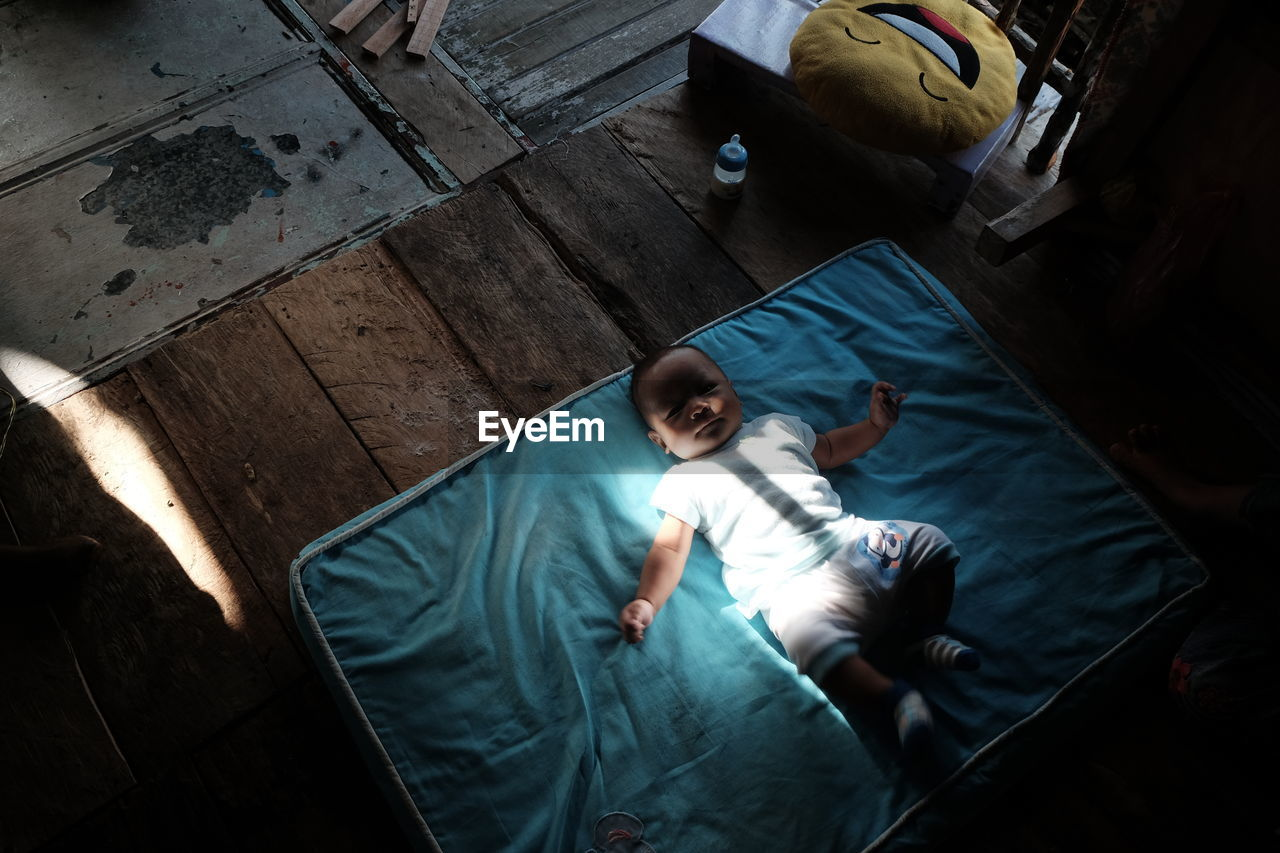 High Angle View Of Baby Boy On Blanket