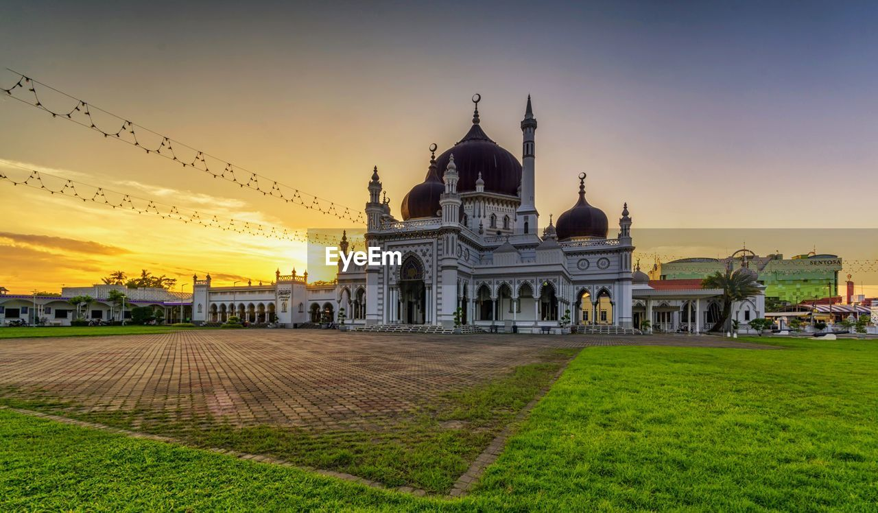 architecture, built structure, building exterior, sunset, history, religion, spirituality, travel destinations, dome, travel, tourism, outdoors, grass, sky, place of worship, no people, nature, ancient civilization, day