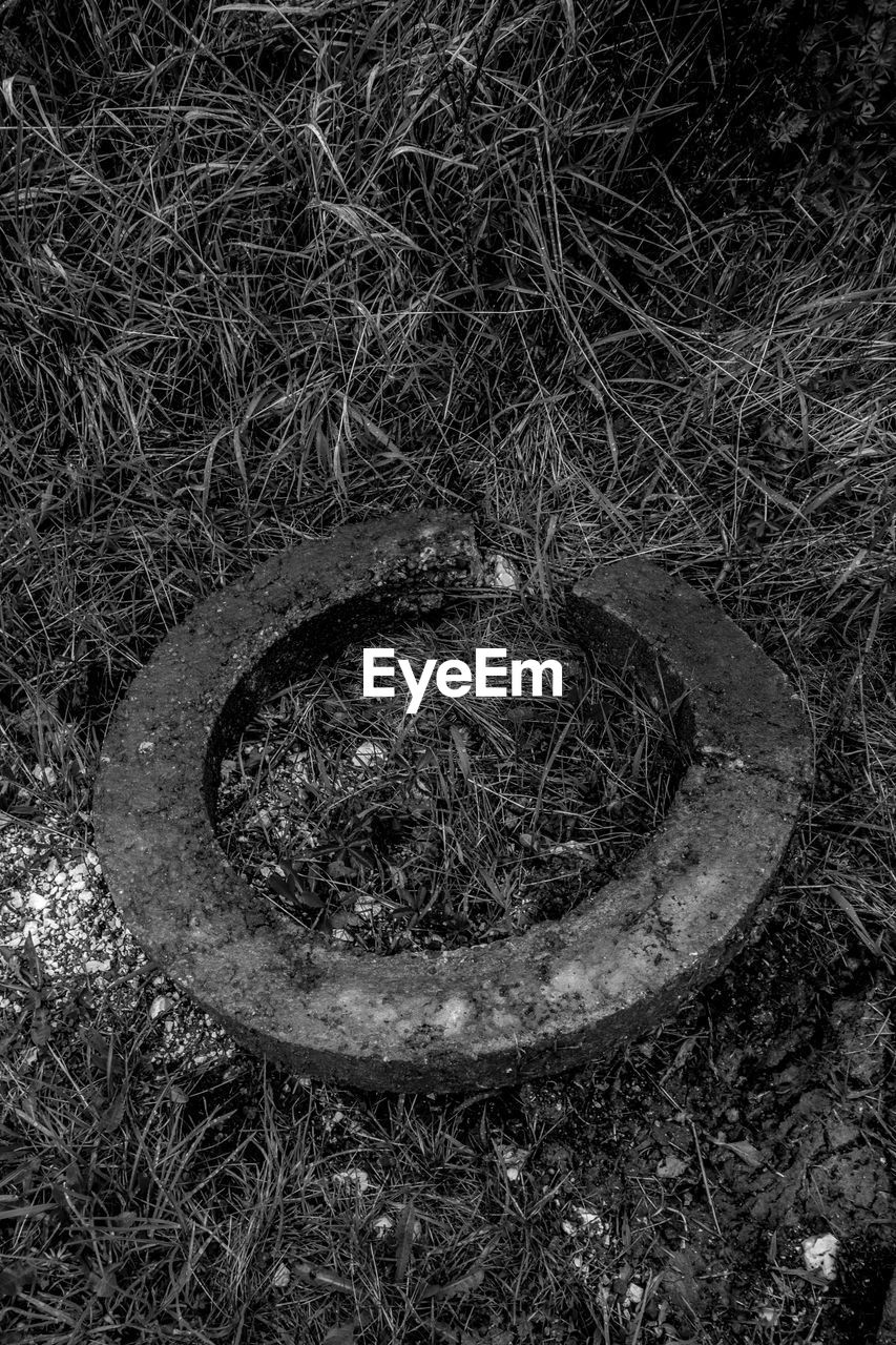 circle, no people, grass, outdoors, field, sewer, day, growth, high angle view, sewage, nature, close-up