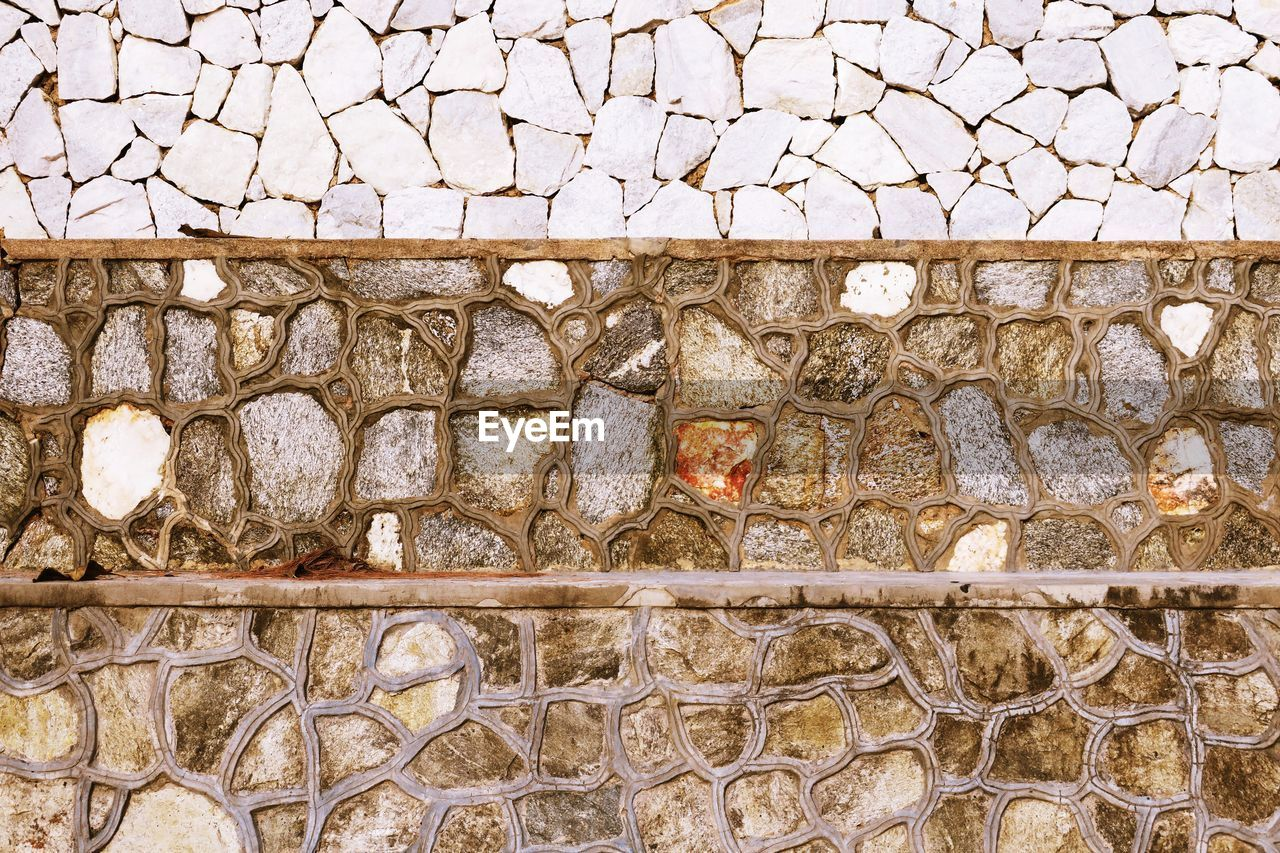 stone wall, wall, architecture, built structure, solid, no people, wall - building feature, stone material, day, pattern, stone - object, textured, outdoors, old, nature, railing, rough, building exterior, rock, full frame