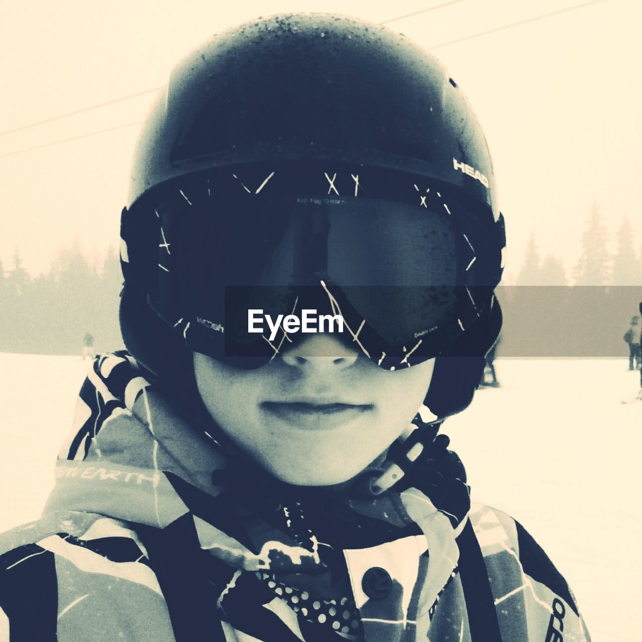 helmet, front view, headwear, portrait, one person, headshot, sports helmet, childhood, real people, crash helmet, looking at camera, leisure activity, boys, cold temperature, adventure, day, outdoors, snow, elementary age, sports clothing, lifestyles, close-up, ski goggles, winter, warm clothing, army helmet, sky, cycling helmet, people