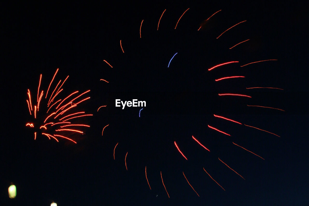 celebration, firework display, firework - man made object, night, exploding, arts culture and entertainment, event, motion, low angle view, no people, illuminated, firework, outdoors, close-up, sky