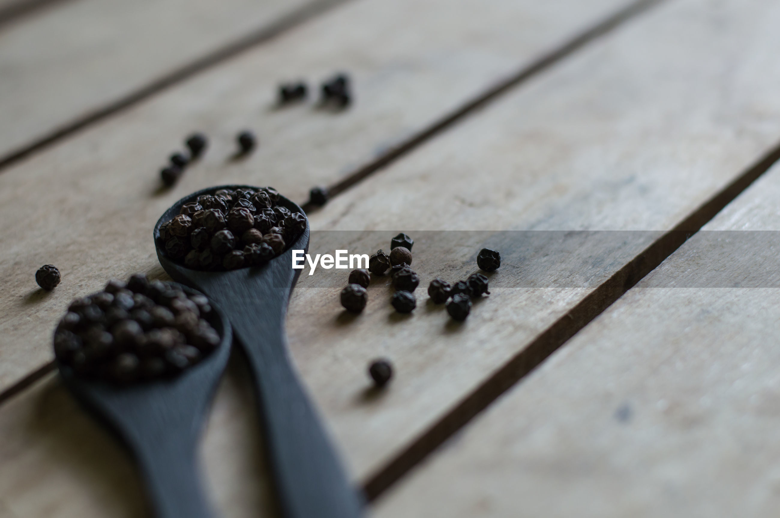 High angle view of black peppercorn on table
