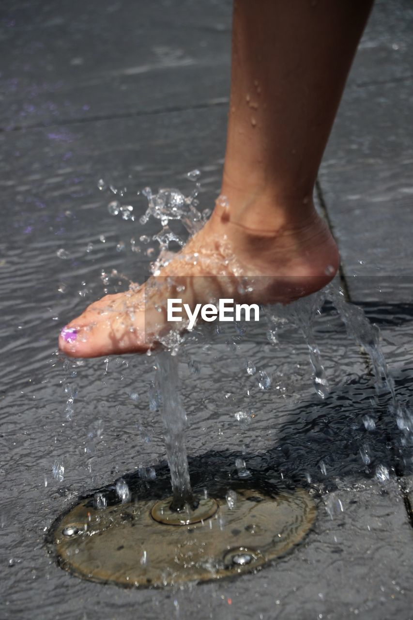 human body part, body part, water, low section, human leg, one person, real people, wet, lifestyles, barefoot, human foot, day, outdoors, motion, splashing, leisure activity, nature, high angle view, human limb