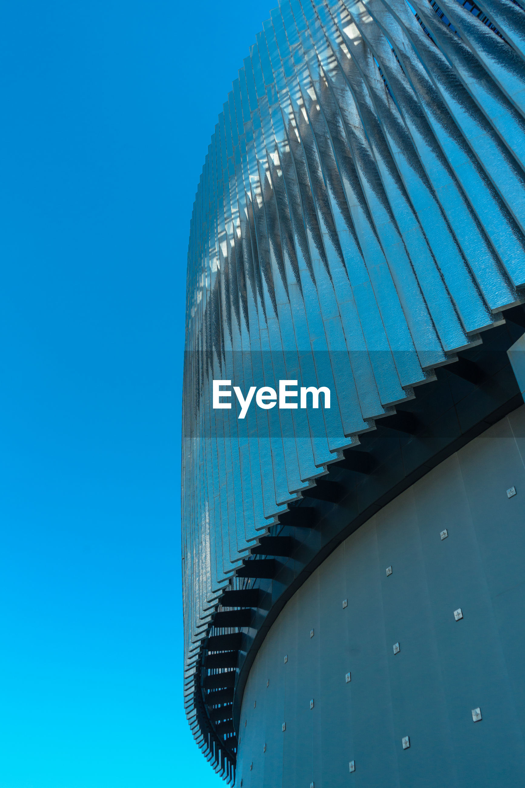 LOW ANGLE VIEW OF METAL STRUCTURE AGAINST BLUE SKY