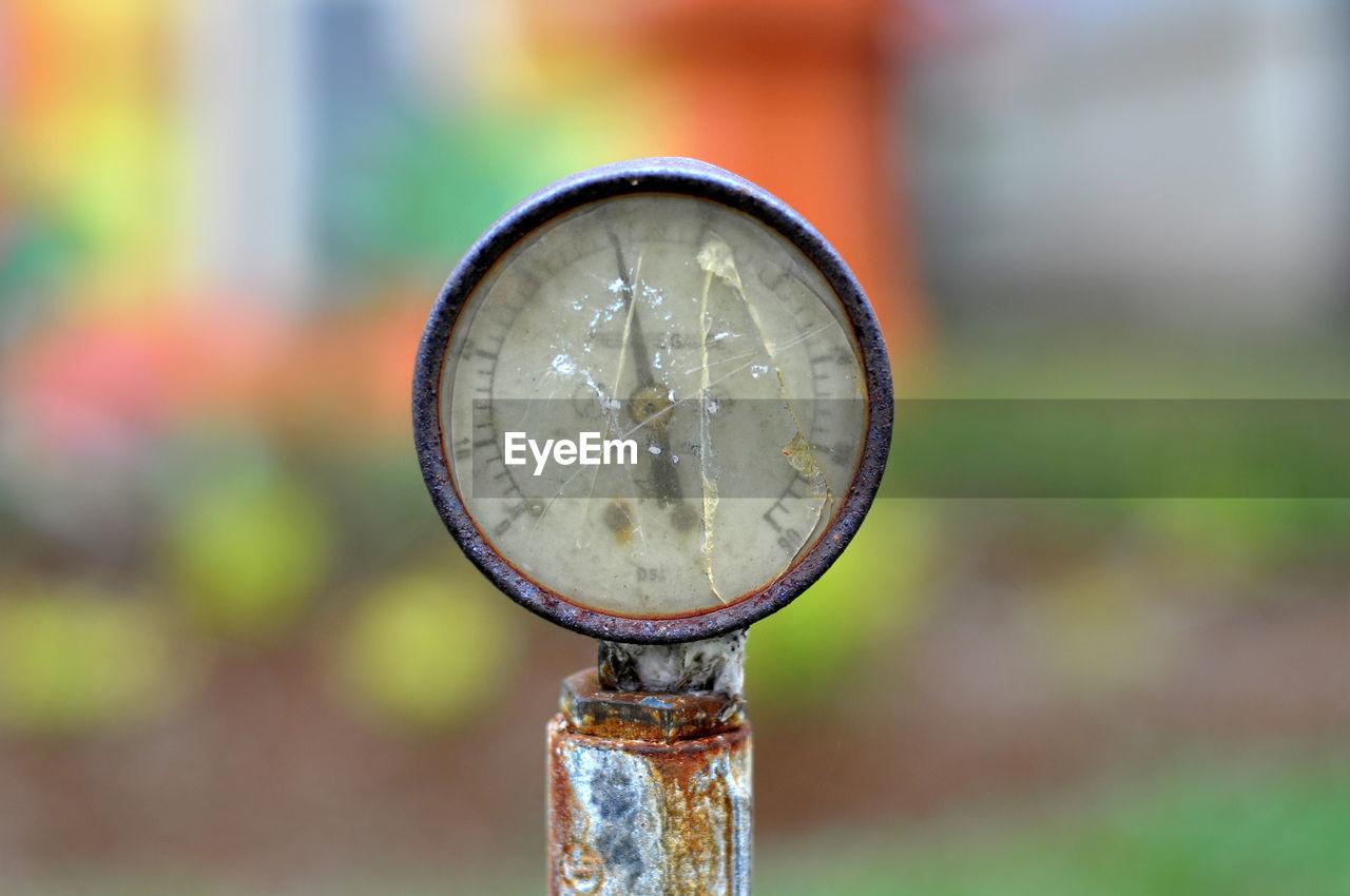 Close-up of damaged gauge against blurred background
