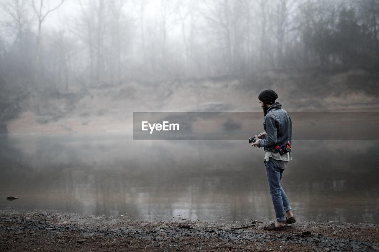 Full Length Of Man Standing At River