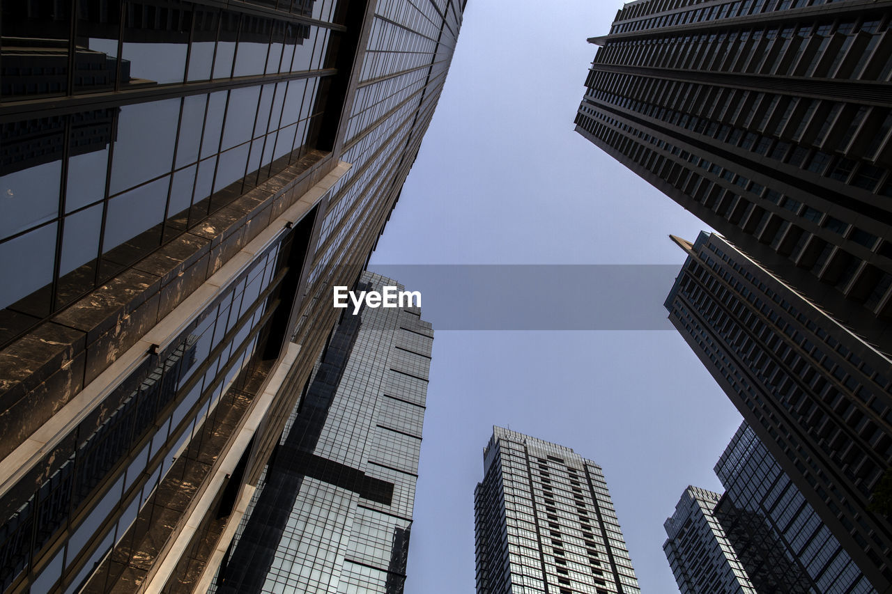 architecture, building exterior, built structure, low angle view, building, sky, city, office building exterior, office, tall - high, modern, skyscraper, no people, nature, clear sky, tower, day, glass - material, outdoors, window, financial district