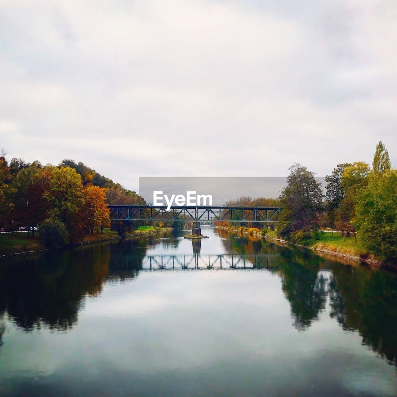 water, sky, tree, reflection, plant, cloud - sky, nature, beauty in nature, waterfront, bridge, tranquility, autumn, no people, connection, architecture, built structure, tranquil scene, scenics - nature, day, bridge - man made structure, outdoors, change
