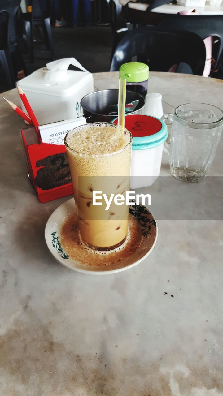 food and drink, drink, table, refreshment, drinking glass, freshness, indoors, drinking straw, indulgence, serving size, cafe, sweet food, food, iced coffee, no people, close-up, ready-to-eat, frothy drink, day