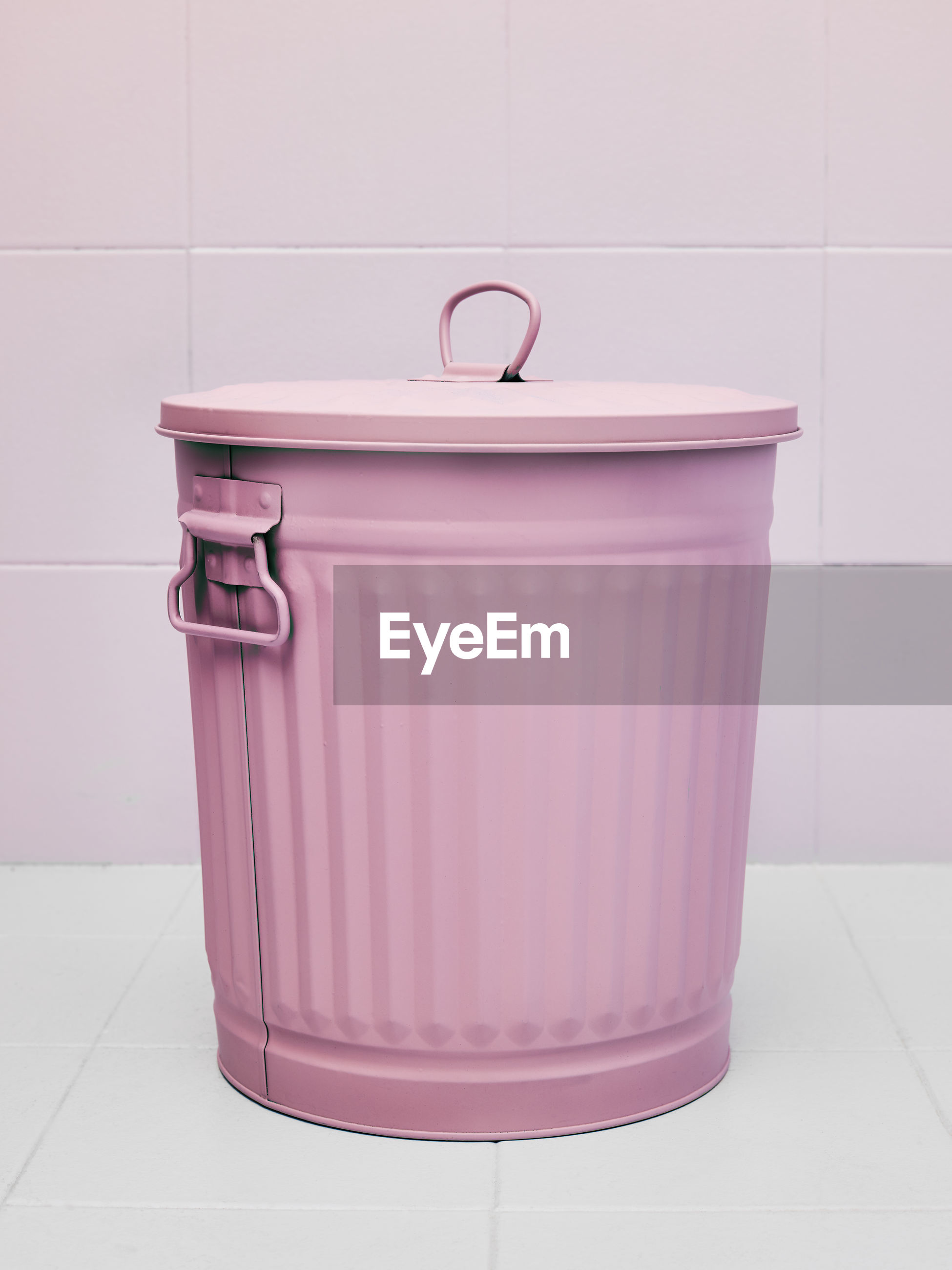 Waste bin or trash can colored pink