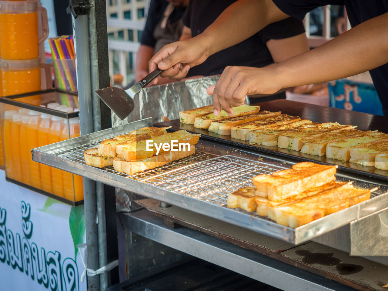 Close-Up Of Grilled Garlic Bread For Sale On Chatuchak Weekend Market, Bangkok, Thailand