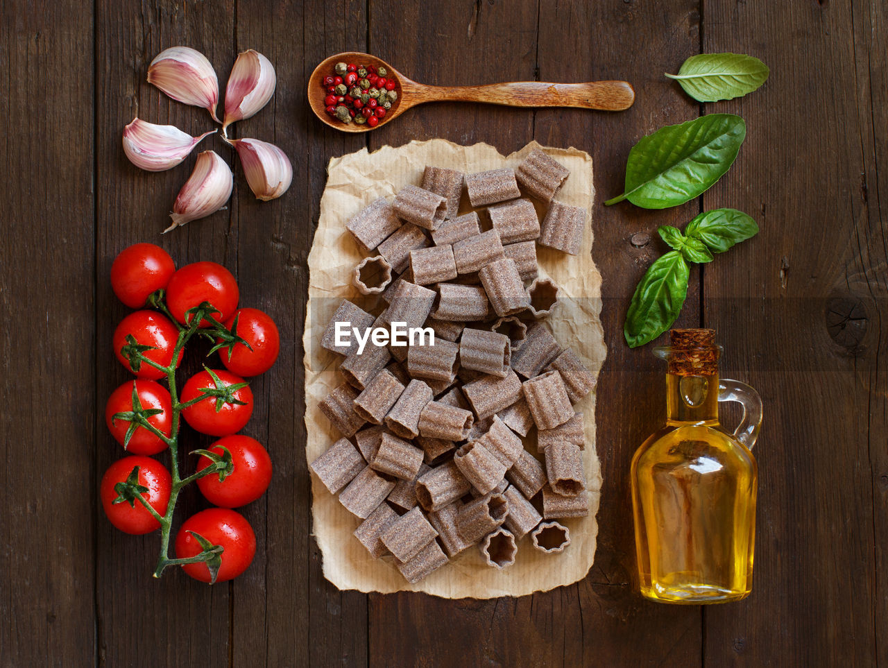 food, food and drink, tomato, vegetable, freshness, directly above, wood - material, healthy eating, wellbeing, indoors, fruit, ingredient, no people, spice, herb, red, large group of objects, table, high angle view, basil, preparation, preparing food