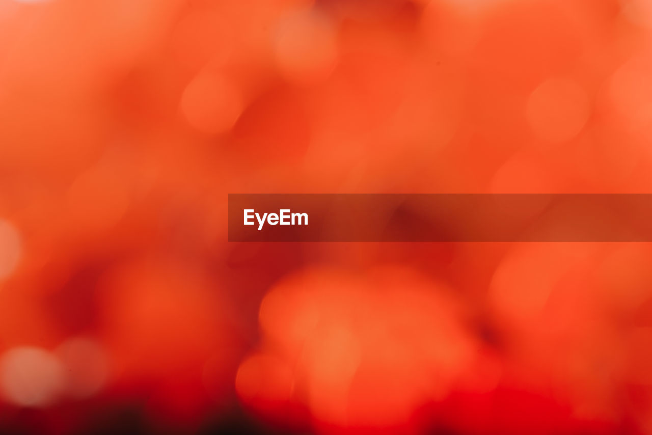 backgrounds, defocused, full frame, abstract, red, close-up, no people, orange color, pattern, selective focus, nature, light - natural phenomenon, beauty in nature, abstract backgrounds, blurred motion, outdoors, growth, tranquility, illuminated, soft focus, softness