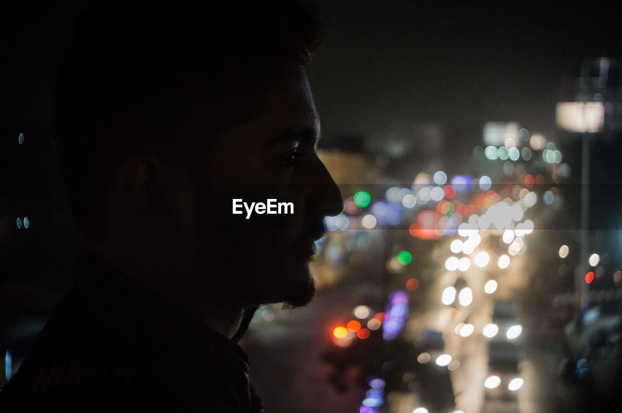 Close-Up Of Man In Illuminated City