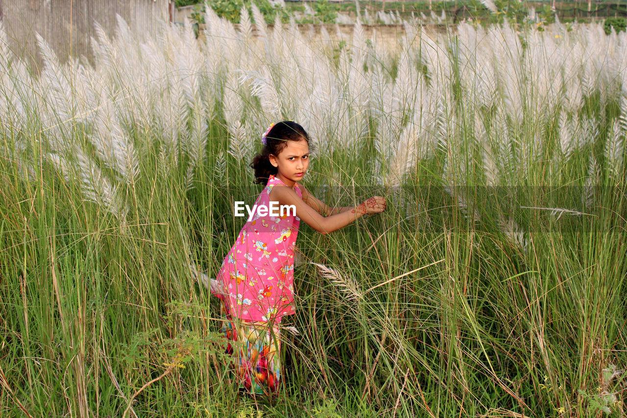 Full length of girl on grassy field