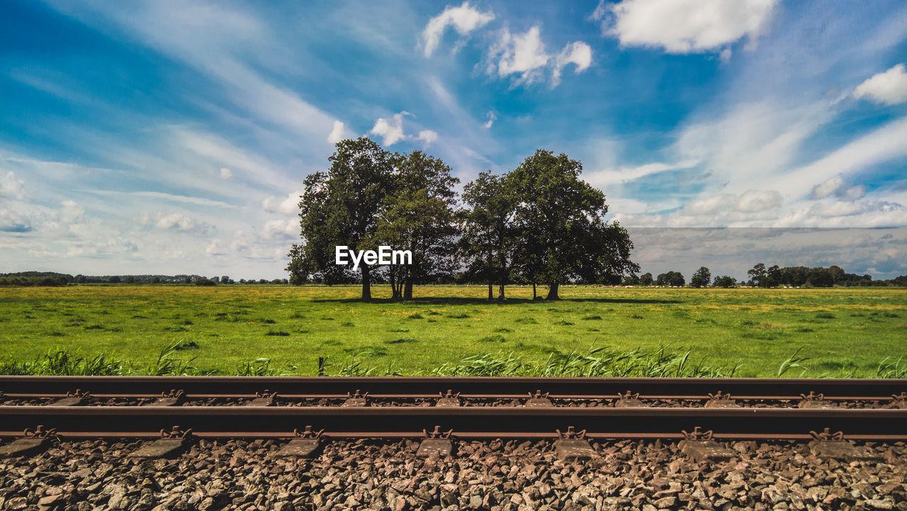 Railway Tracks Against Trees On Landscape