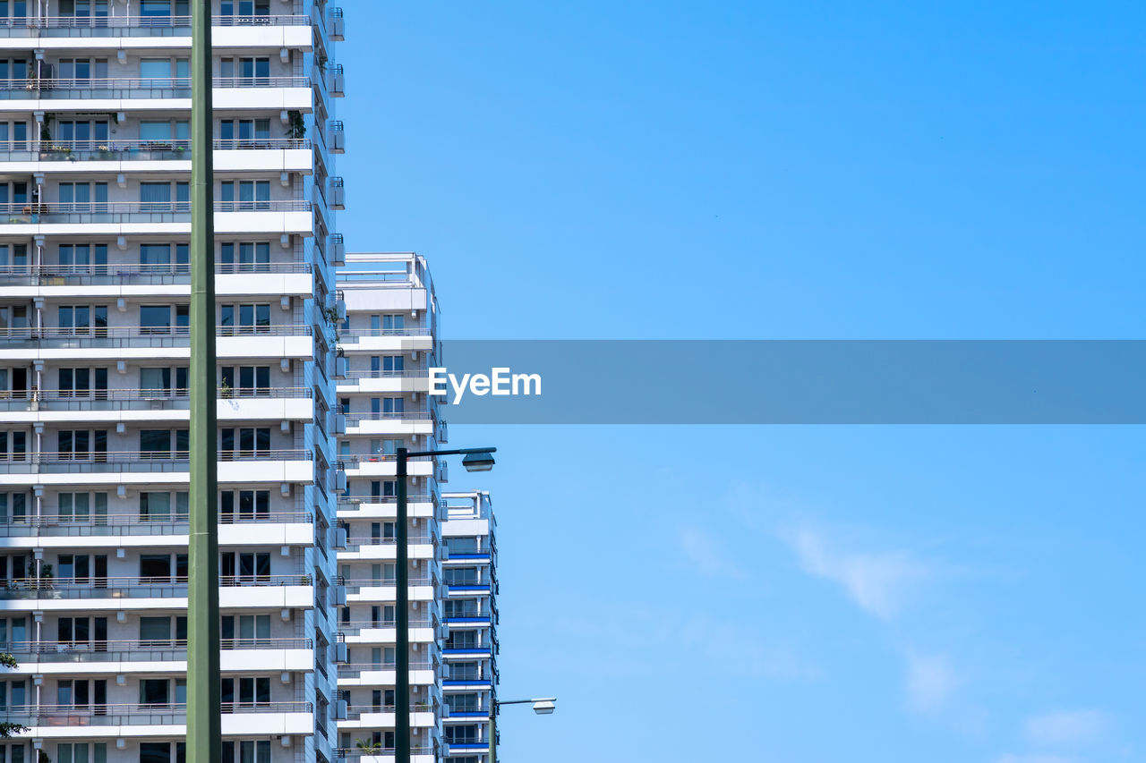 Low Angle View Of Modern Buildings Against Blue Sky