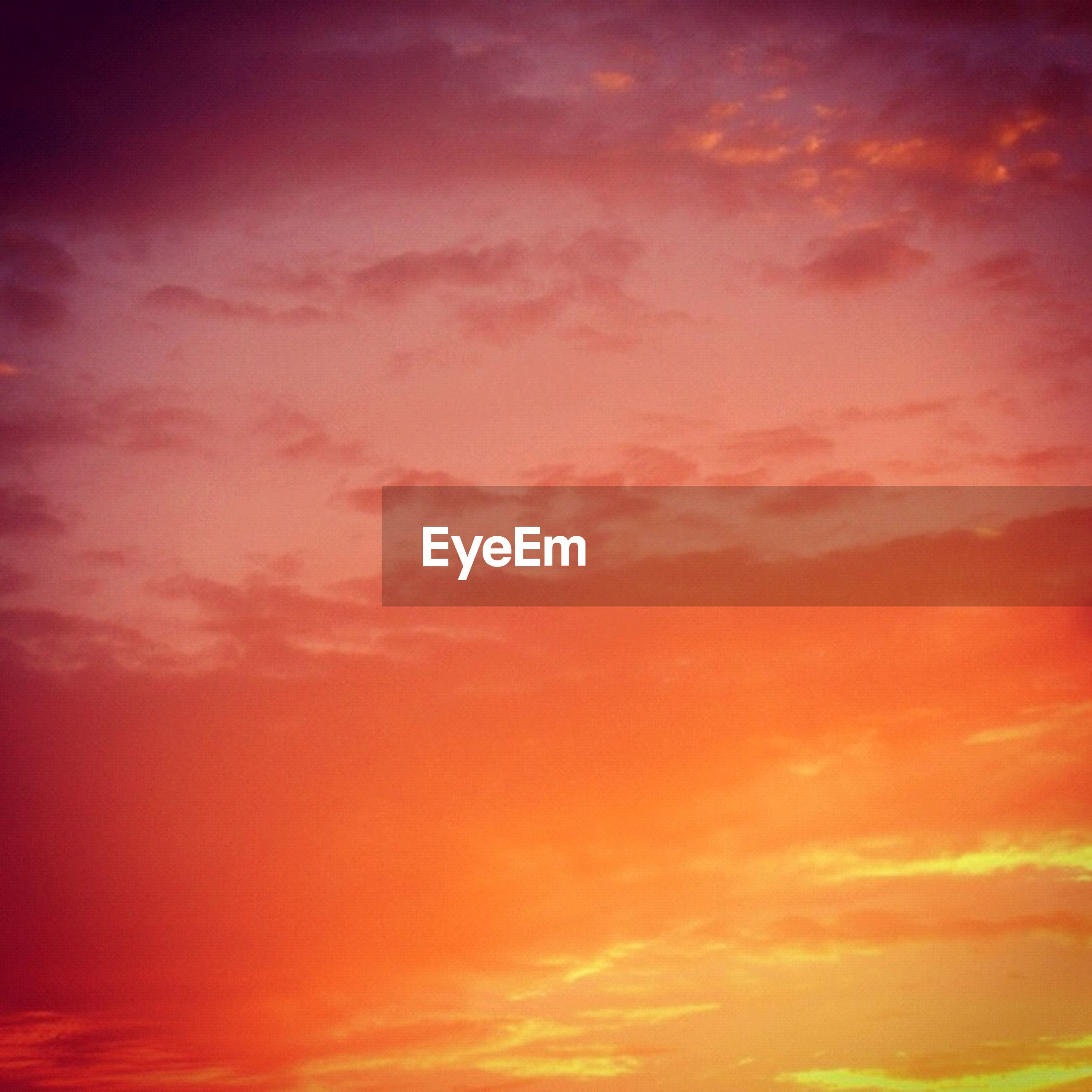 sunset, orange color, sky, beauty in nature, low angle view, scenics, cloud - sky, tranquility, backgrounds, sky only, tranquil scene, nature, red, idyllic, full frame, cloudy, dramatic sky, cloud, outdoors, no people