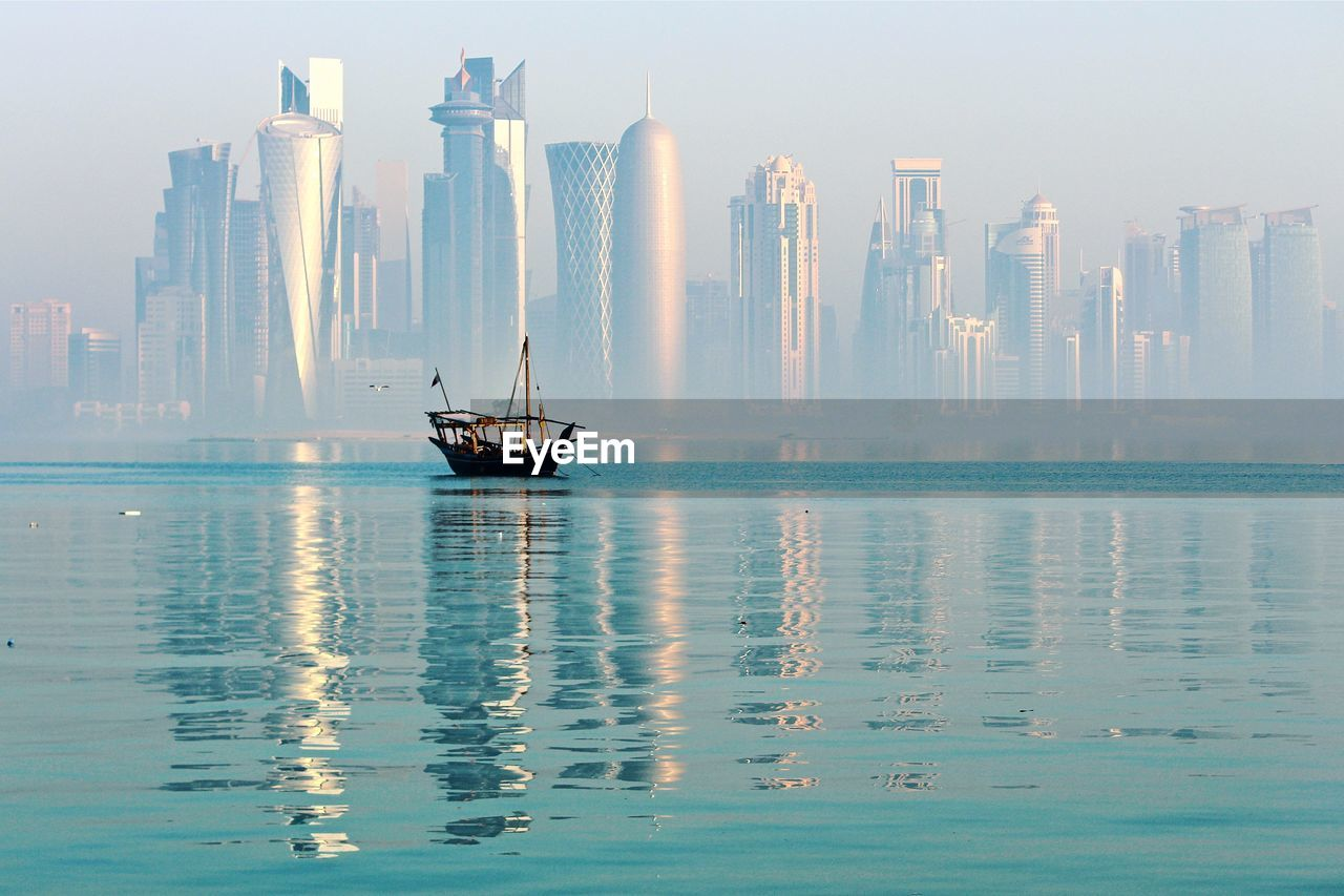 Sea Against Modern Buildings In City
