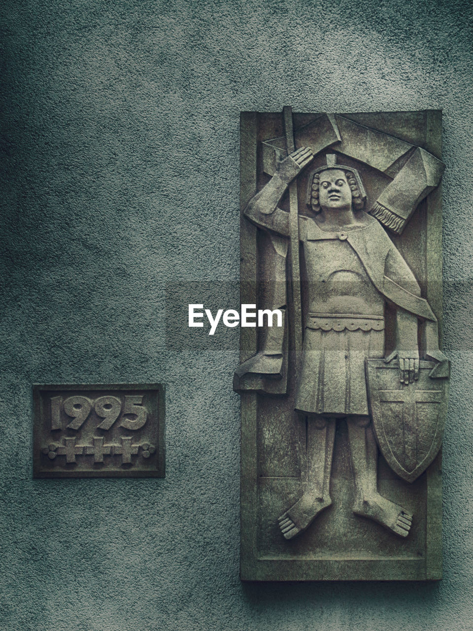 art and craft, human representation, representation, no people, sculpture, craft, wall - building feature, architecture, creativity, male likeness, close-up, text, statue, day, carving - craft product, built structure, communication, wall, religion, female likeness, carving, bas relief