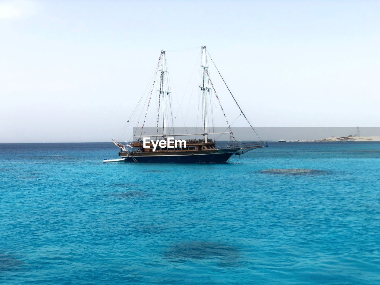 sea, transportation, nautical vessel, water, mode of transportation, sailboat, sky, sailing, pole, day, horizon over water, scenics - nature, waterfront, nature, beauty in nature, ship, horizon, mast, no people, outdoors, yacht, luxury, turquoise colored, yachting