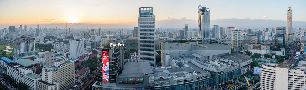 skyscraper, architecture, building exterior, city, cityscape, tall - high, built structure, modern, outdoors, urban skyline, sunset, downtown district, no people, sky, travel destinations, day