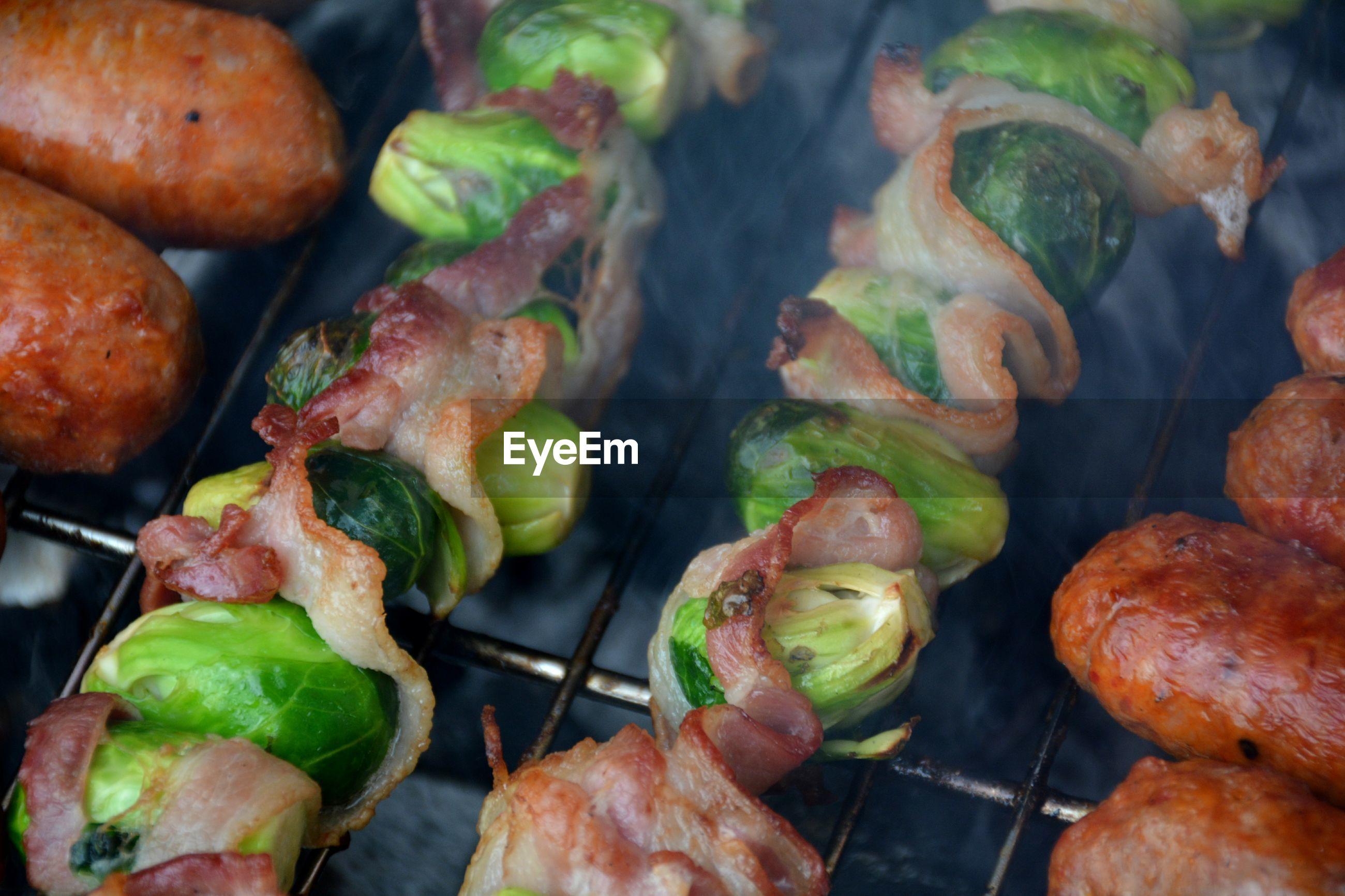 High angle view of meat and vegetables on barbecue grill