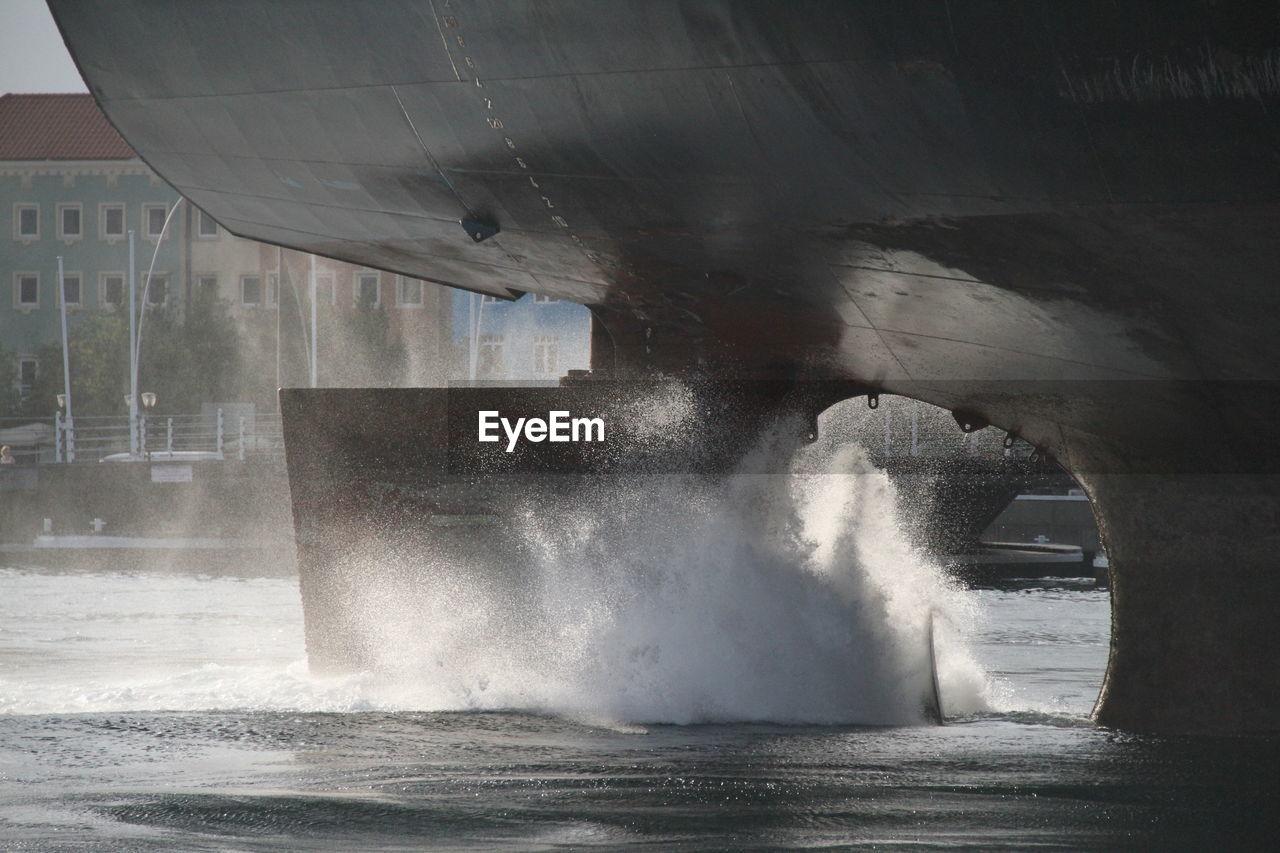 Water splashing by ship on river