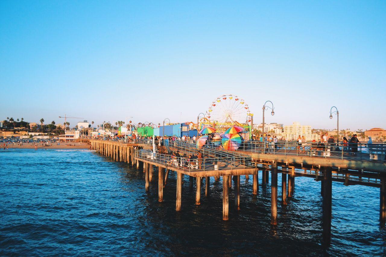 Santa Monica Pier Over Sea Against Clear Sky