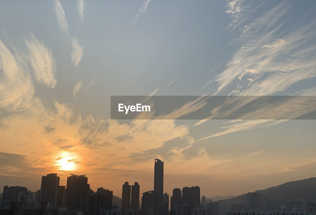 SCENIC VIEW OF SILHOUETTE BUILDINGS AGAINST SKY DURING SUNSET