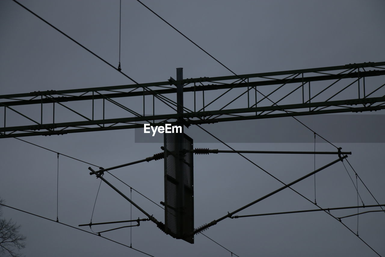 connection, cable, low angle view, electricity, sky, technology, power line, power supply, electricity pylon, no people, metal, fuel and power generation, complexity, nature, architecture, clear sky, built structure, outdoors, day, dusk, electrical equipment, directly below