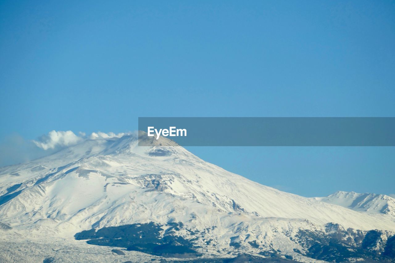mountain, cold temperature, snow, winter, sky, scenics - nature, beauty in nature, snowcapped mountain, tranquil scene, tranquility, copy space, blue, clear sky, non-urban scene, nature, idyllic, environment, landscape, no people, mountain range, mountain peak