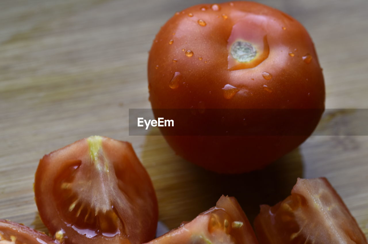 food, food and drink, healthy eating, fruit, freshness, wellbeing, close-up, still life, no people, tomato, vegetable, table, focus on foreground, red, apple - fruit, indoors, wet, wood - material, day, ripe, temptation