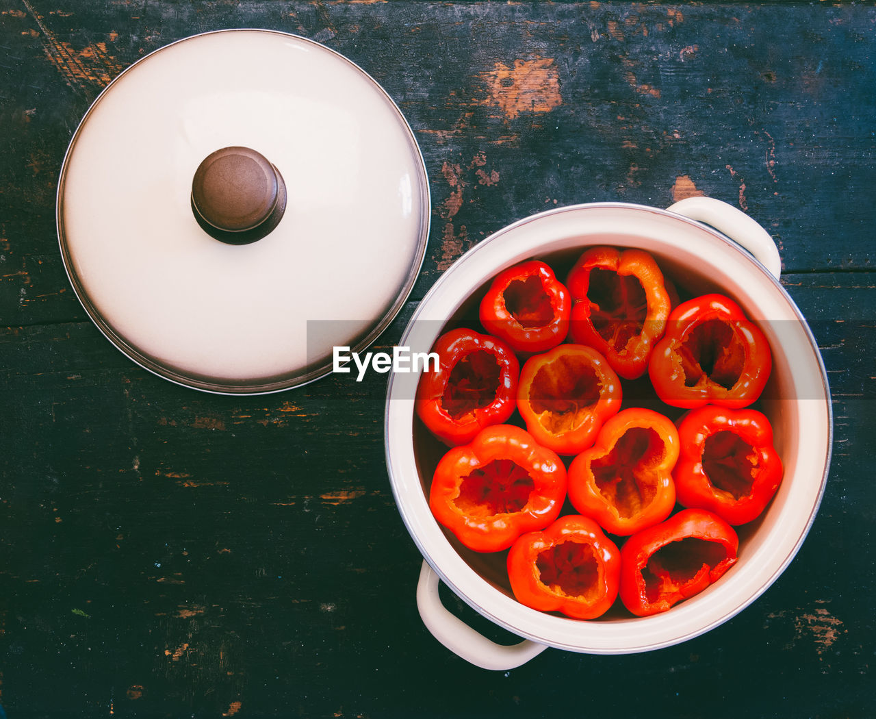 High angle view of bell peppers in pan on table