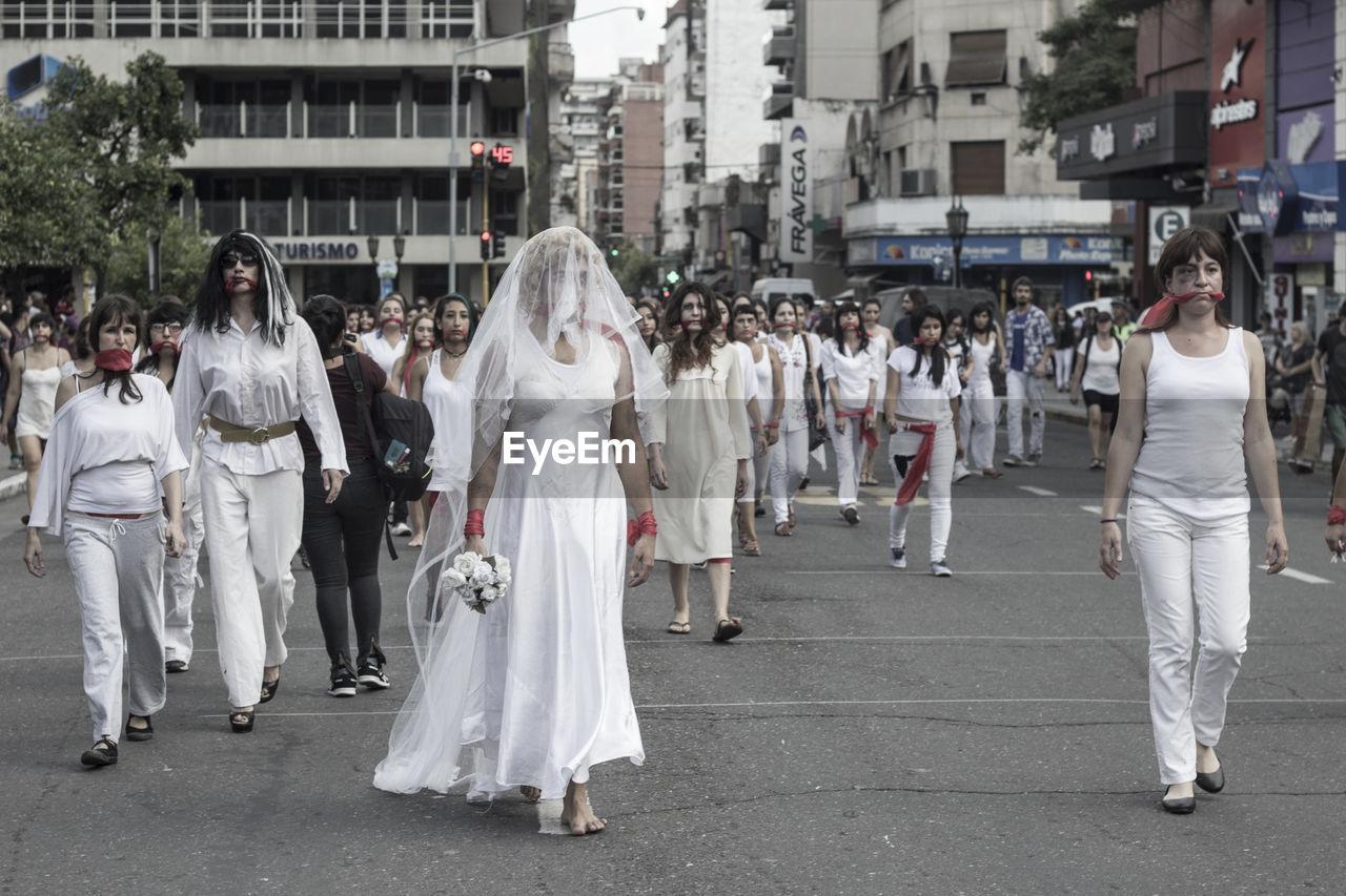 GROUP OF PEOPLE WALKING IN STREET