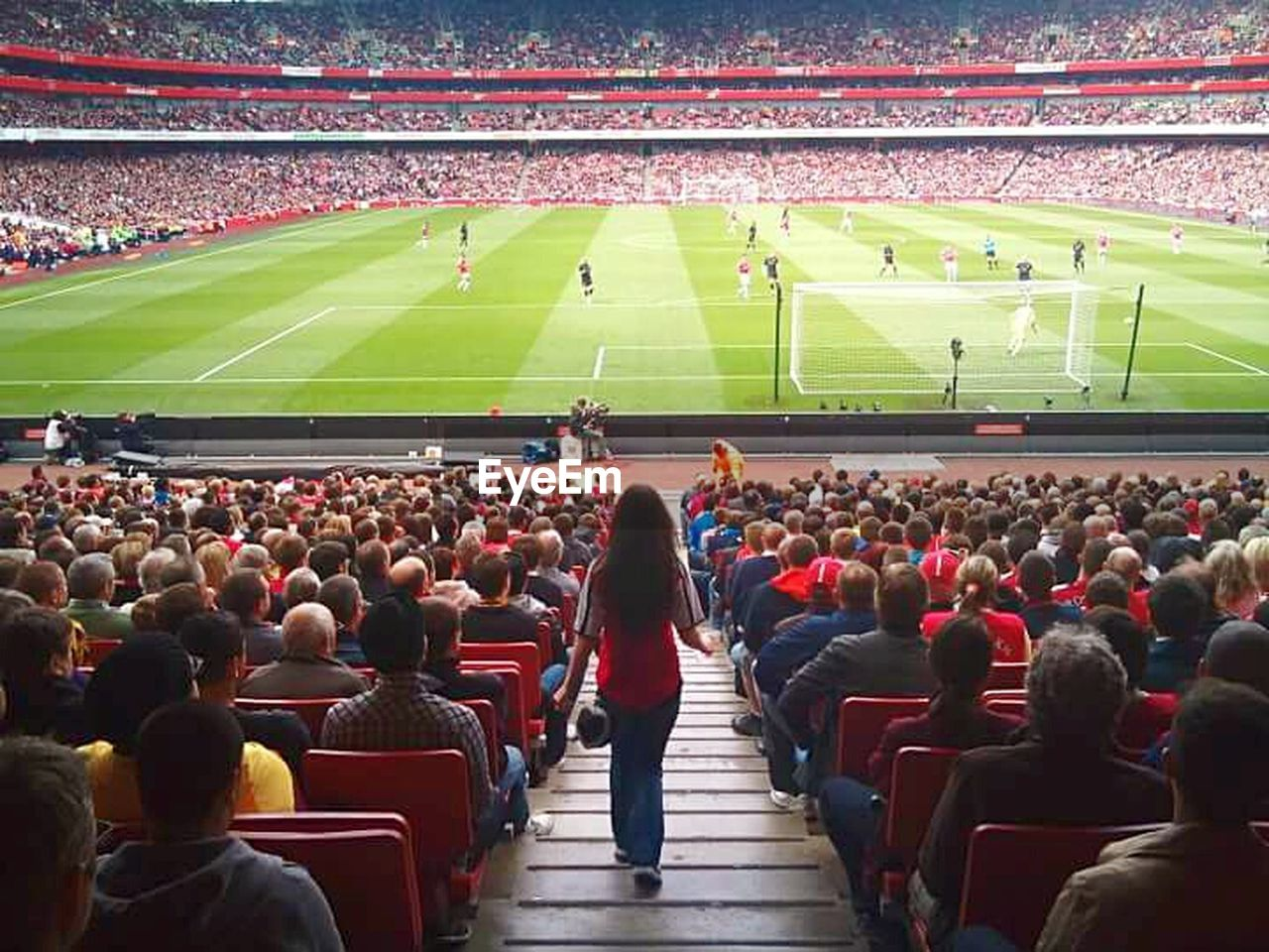 stadium, spectator, crowd, fan - enthusiast, audience, large group of people, event, sports team, grass, soccer, outdoors, togetherness, day, cheering, american football - sport, people, adult, adults only