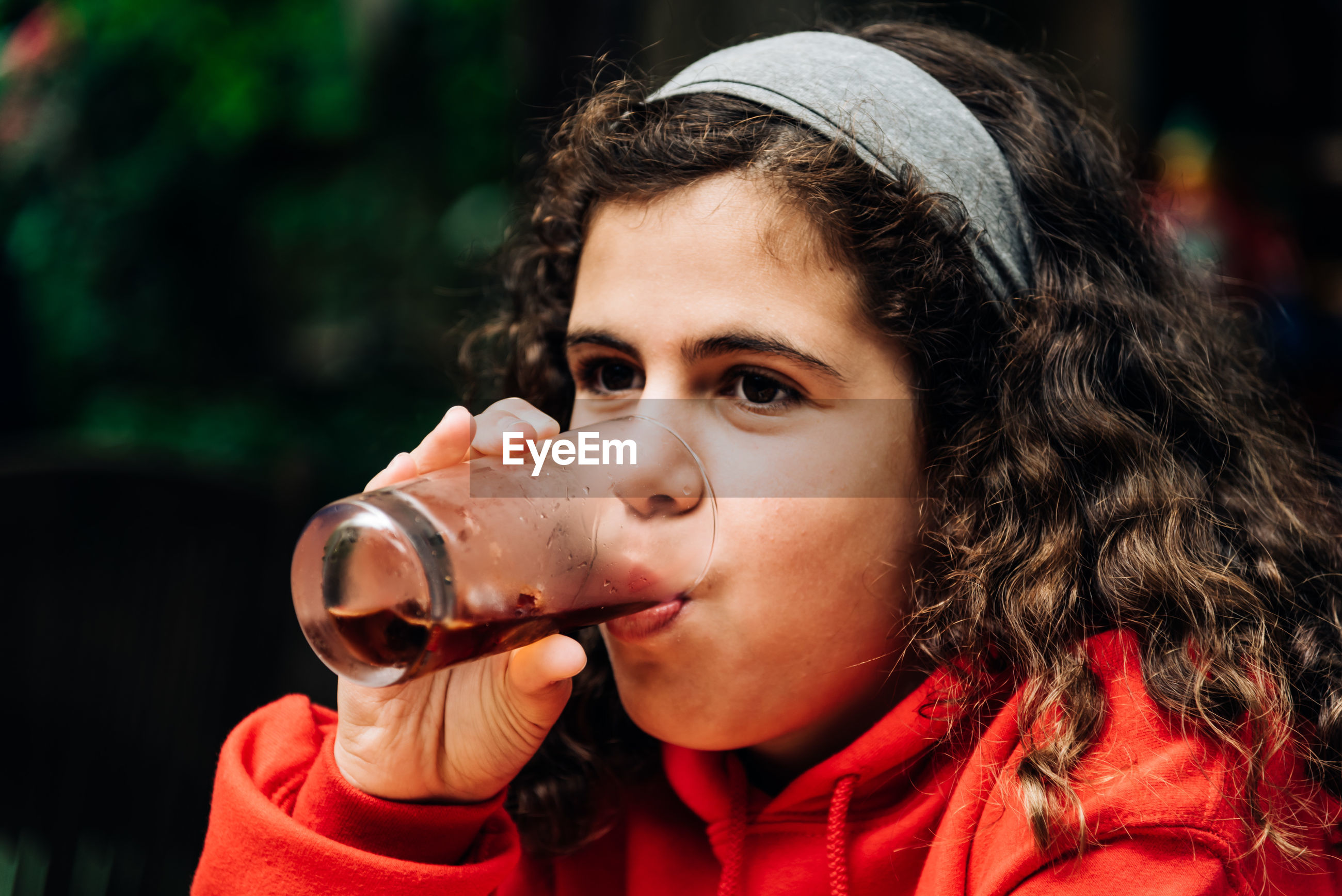 Close-up portrait of girl drinking