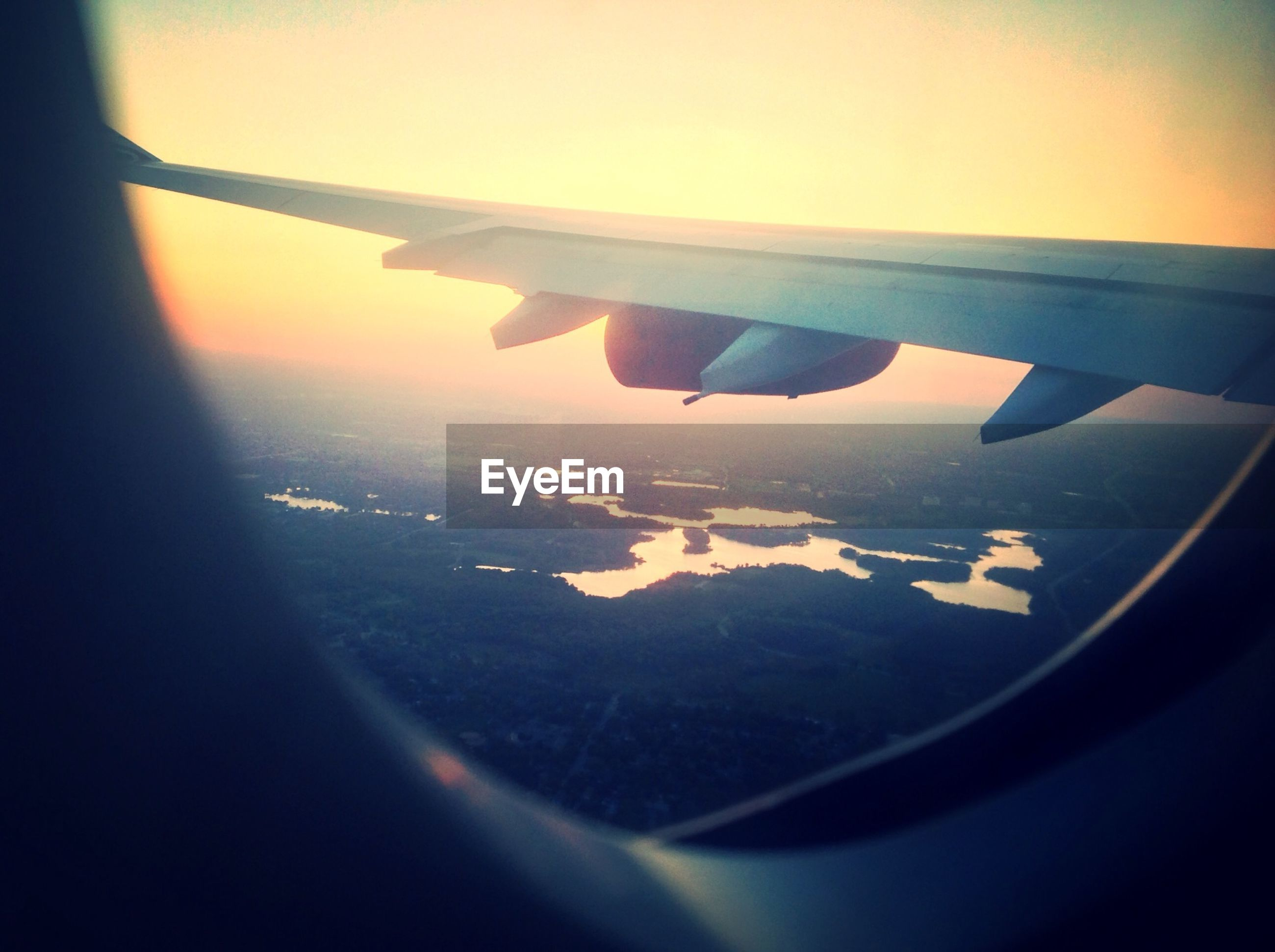 airplane, transportation, flying, air vehicle, aircraft wing, aerial view, mode of transport, vehicle interior, landscape, part of, window, cropped, sky, scenics, travel, mid-air, sunset, beauty in nature, transparent, glass - material