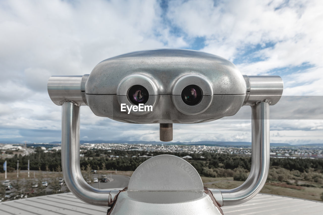 binoculars, coin operated, cloud - sky, sky, coin-operated binoculars, day, nature, surveillance, no people, close-up, security, metal, city, outdoors, tourism, architecture, observation point, travel, cityscape, railing, silver colored, hand-held telescope