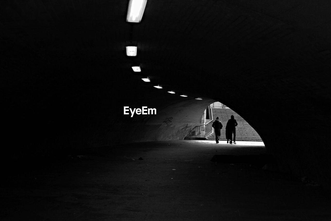 Silhouette People Walking In Underground Walkway