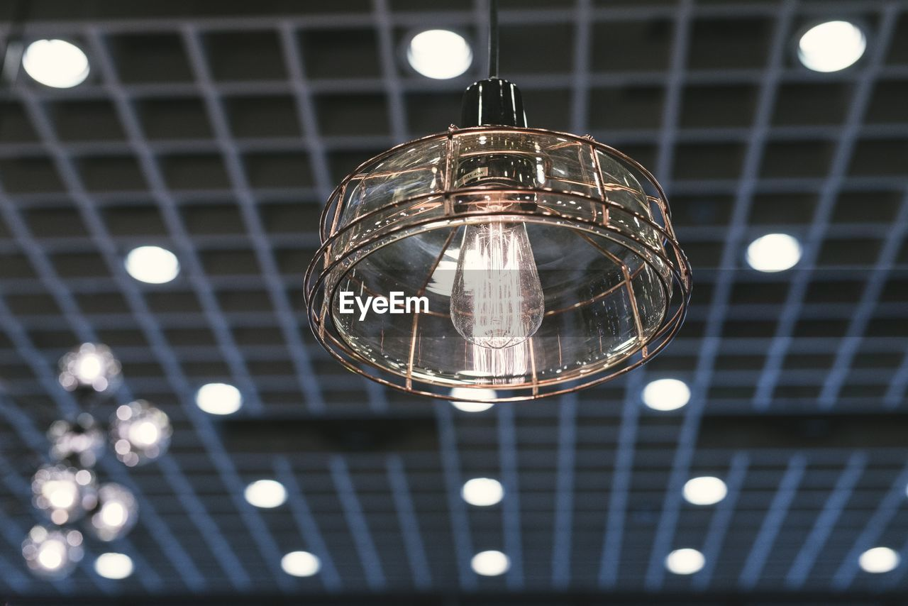 illuminated, lighting equipment, low angle view, electricity, light bulb, hanging, electric light, ceiling, bulb, no people, focus on foreground, close-up, indoors, night, filament