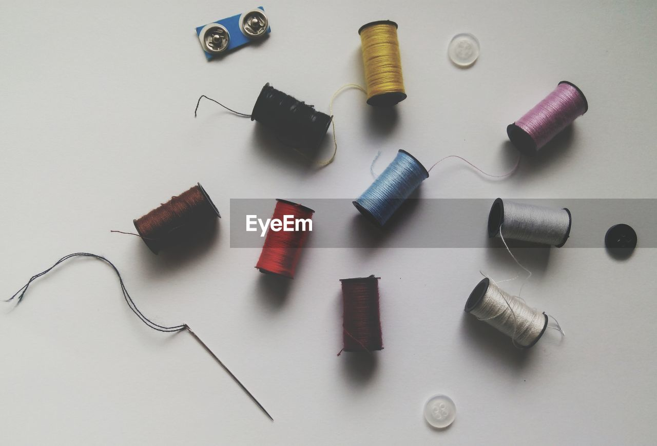 Reels of thread over white background