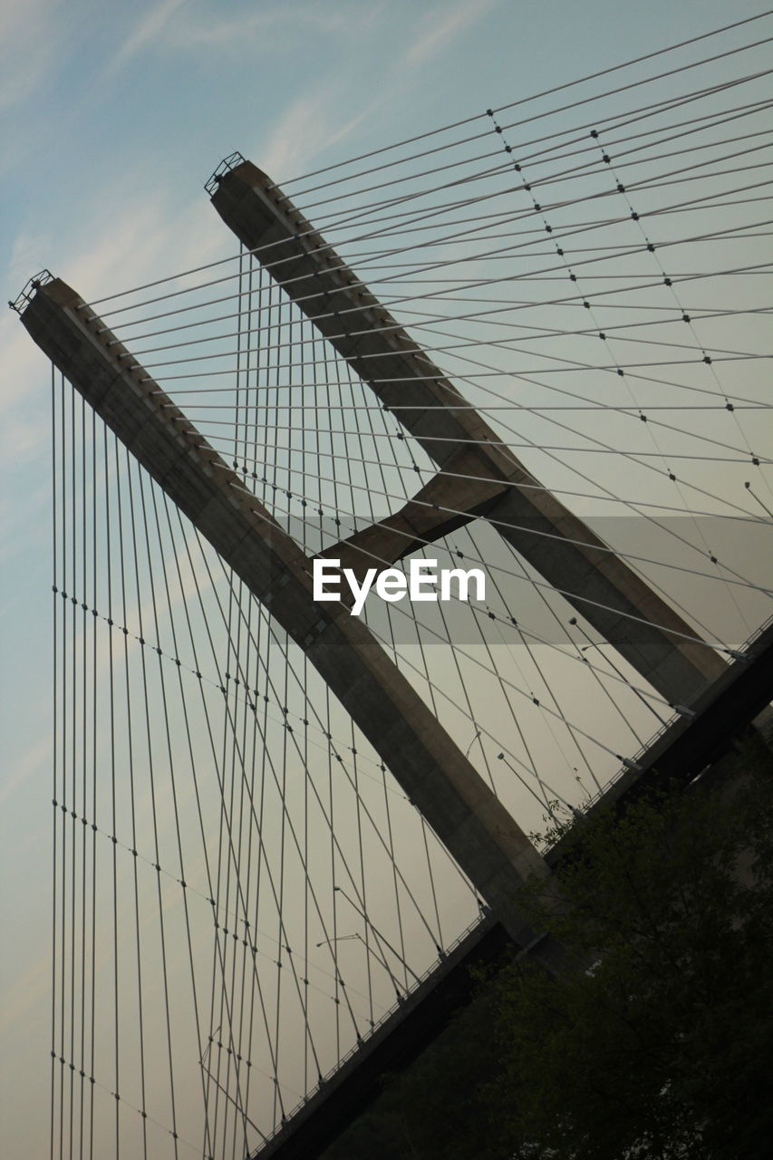 sky, built structure, low angle view, architecture, no people, nature, bridge, transportation, bridge - man made structure, suspension bridge, cloud - sky, connection, day, outdoors, building exterior, steel cable, cable-stayed bridge, pattern, silhouette