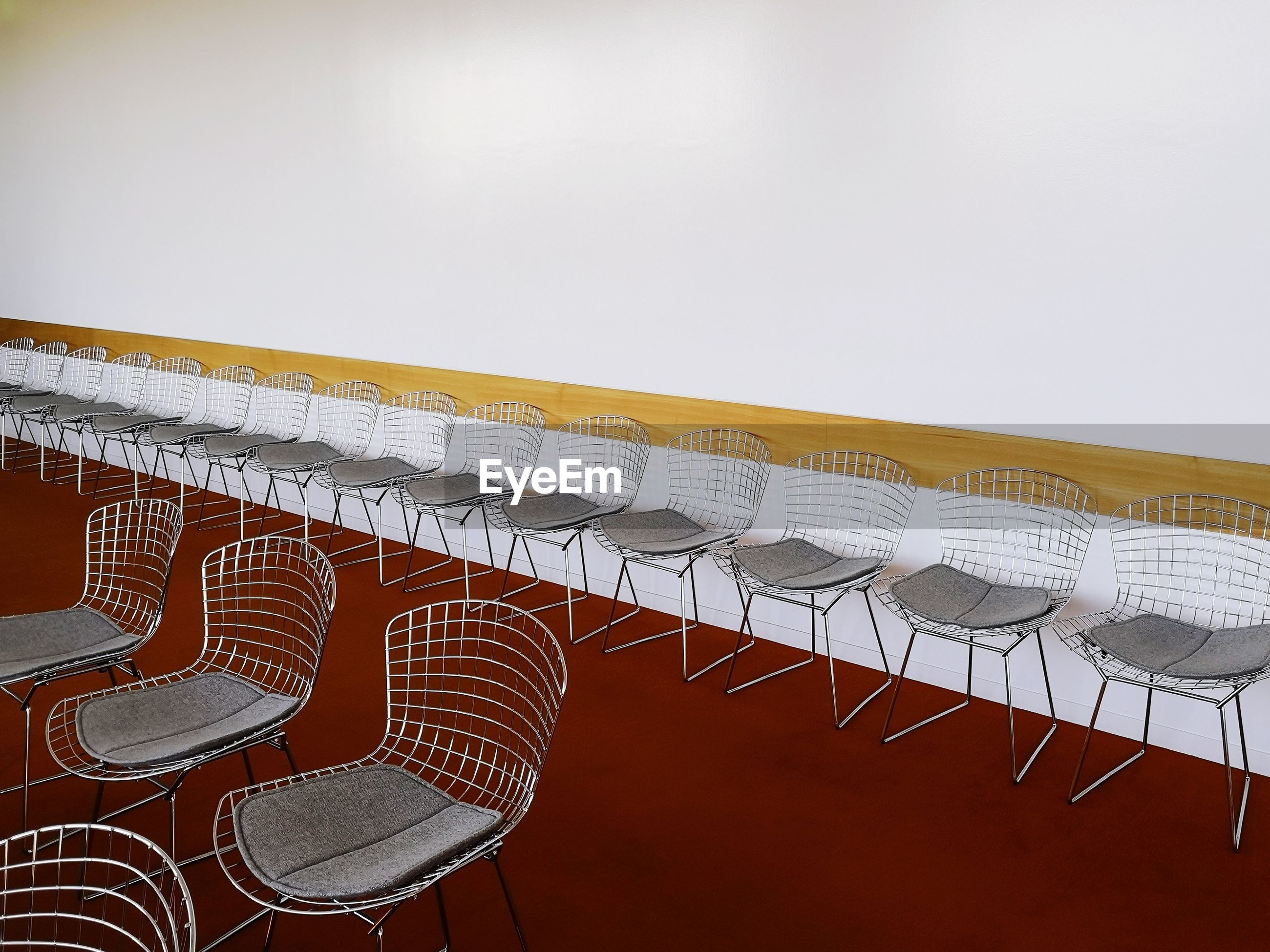Empty chairs arranged in banquet