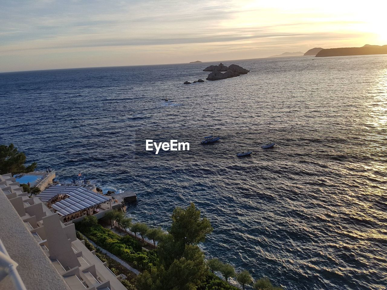 sea, water, nature, sunset, beauty in nature, high angle view, horizon over water, scenics, tranquility, sky, outdoors, no people, architecture, day