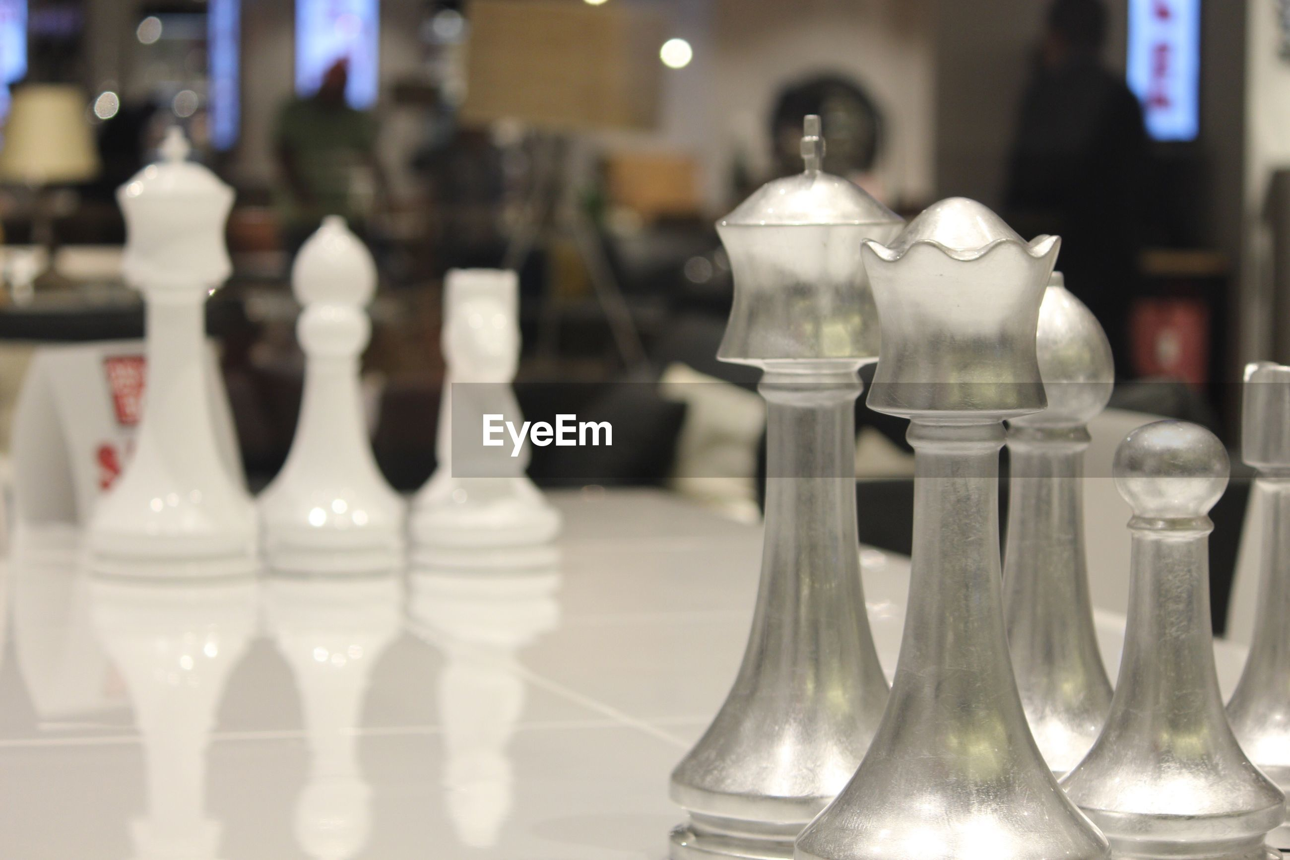 Close-up of glass chess pieces