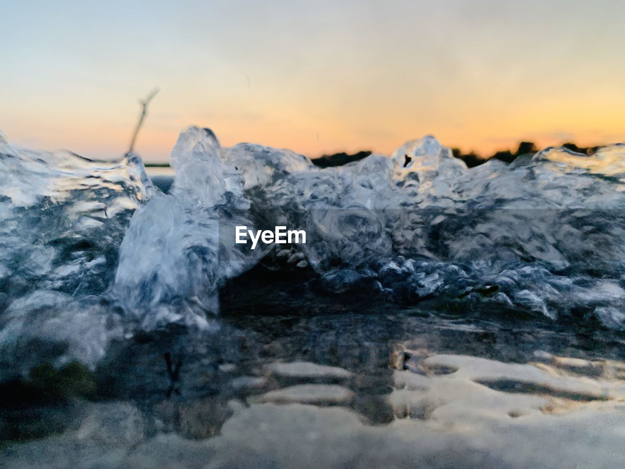water, sunset, sky, beauty in nature, motion, nature, scenics - nature, no people, environment, land, sea, cold temperature, winter, tranquility, splashing, non-urban scene, power in nature, landscape, idyllic, ice, flowing water