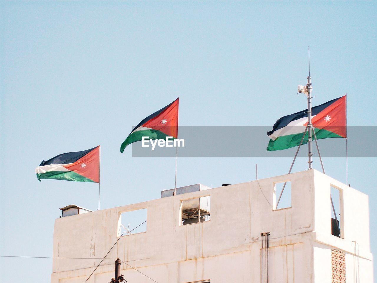 Low angle view of flag of jordan