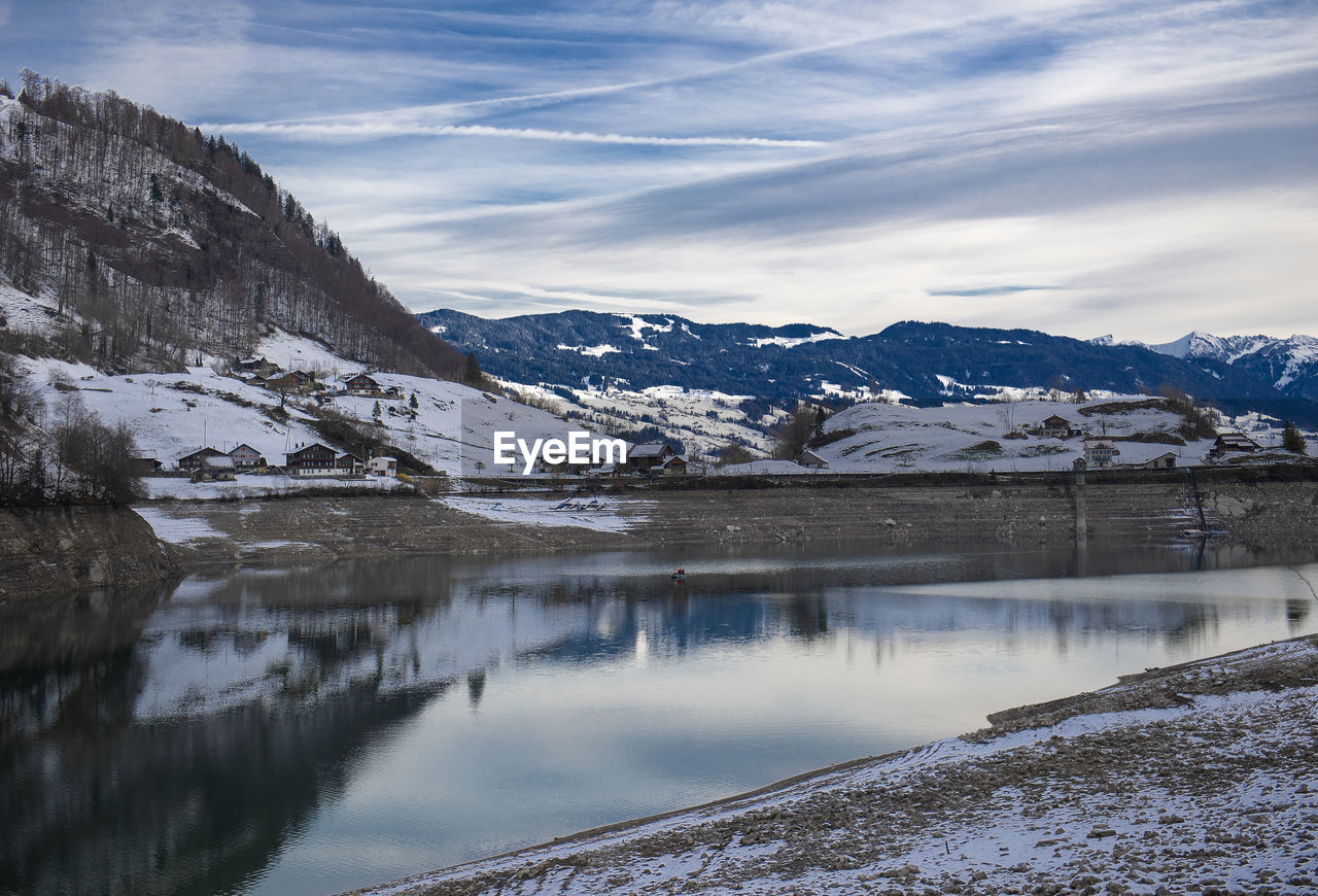 cold temperature, winter, snow, mountain, scenics - nature, water, beauty in nature, tranquil scene, sky, environment, tranquility, cloud - sky, mountain range, no people, snowcapped mountain, nature, landscape, lake, ice, outdoors, iceberg
